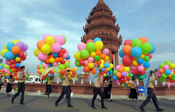 Photo: Cambodian scouts carry balloons during a ceremony marking the Independence Day in Phnom Penh on November 9, 2011. Cambodia was celebrating the 58th anniversary of its independence from France in 1953. TOPSHOTS  AFP PHOTO/TANG CHHIN SOTHY (Photo credit should read TANG CHHIN SOTHY/AFP/Getty Images) [PNG Merlin Archive]