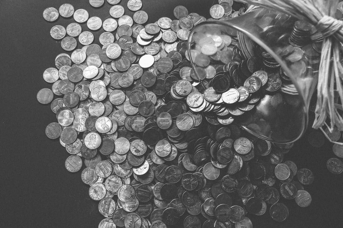 Grayscale Photo of Coins