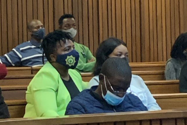 Sgt Catherine Tladi sits with Thuleleni Mtsweni during the sentencing of convicted serial rapist Sello Abram Mapunya in the Pretoria high court on Thursday.