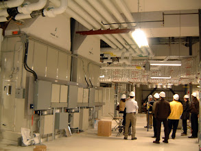 Photo: Group in 5th level penthouse, adjacent to air handlers serving BSL3 Facility and Vivarium (animal housing)