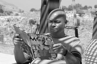 Photo: John reading Mojo in Greece