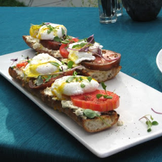 Poached Eggs on Toasted Baguette with Goat Cheese, and Black Pepper Vinaigrette.