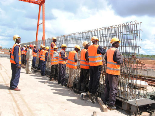 Workers make Standard Gauge Railway reinforcement structures using steel at the Kathekani site, May 1, 2015. /ANDREW KASUKU