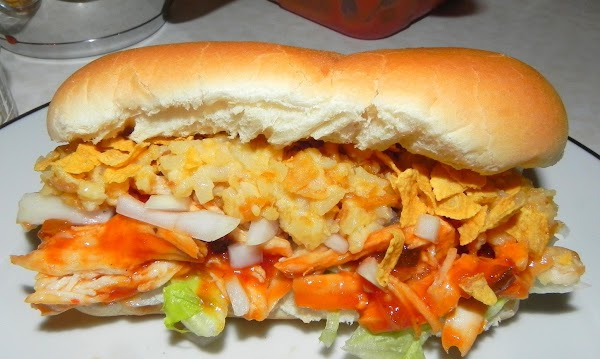 Now assemble the sandwich with lettuce on the bun first, then the bbq chicken,...