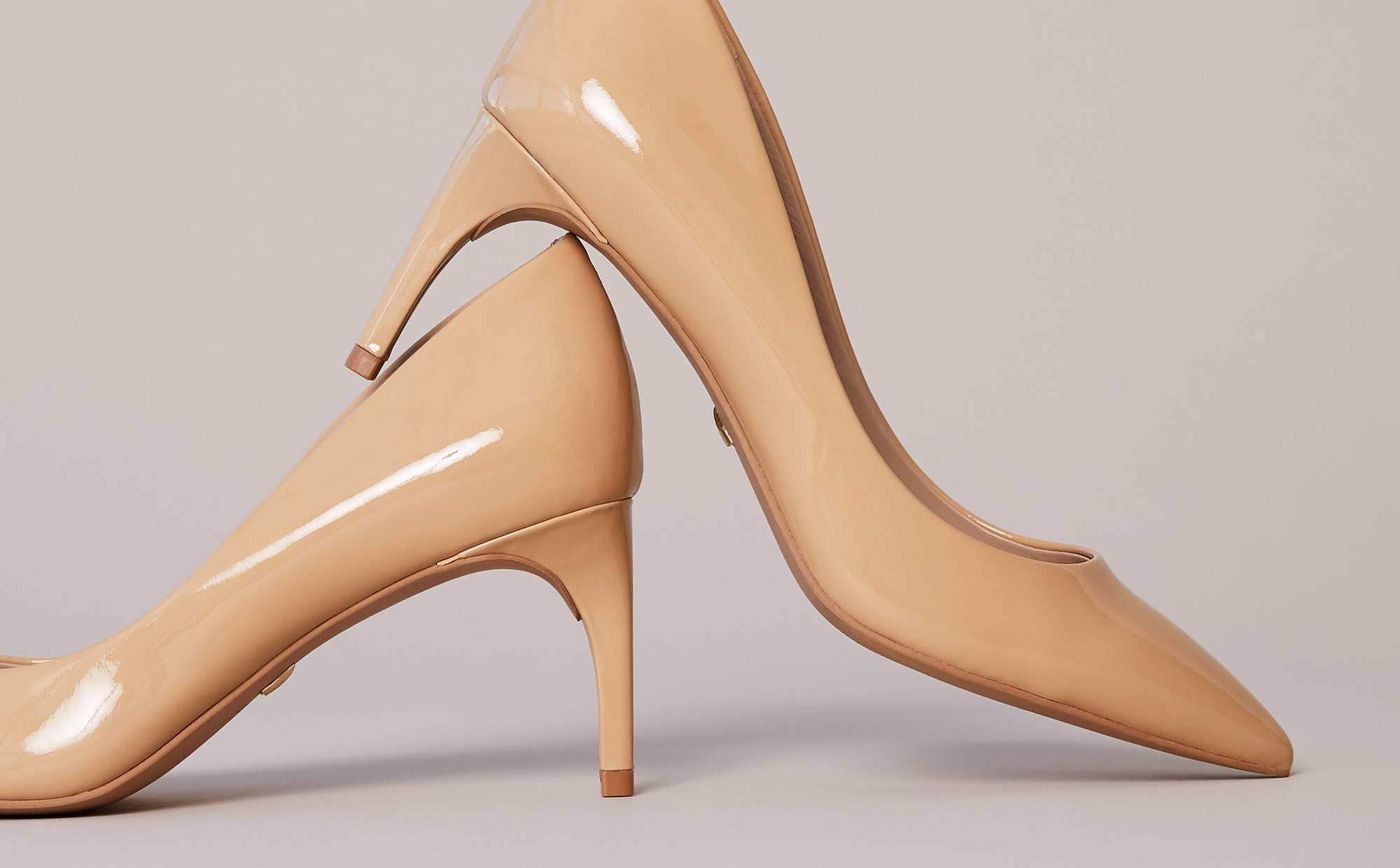 Nude patent leather pumps to wear to a business casual office