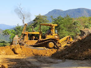Photo: This monsterous bulldozer was equipped with hooks on the rear to keep it from sliding down the mountain.