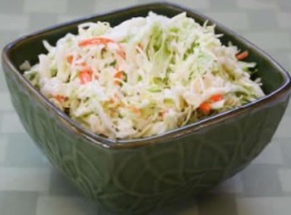 Mix all the ingredients except the cole slaw mix in a very large bowl....