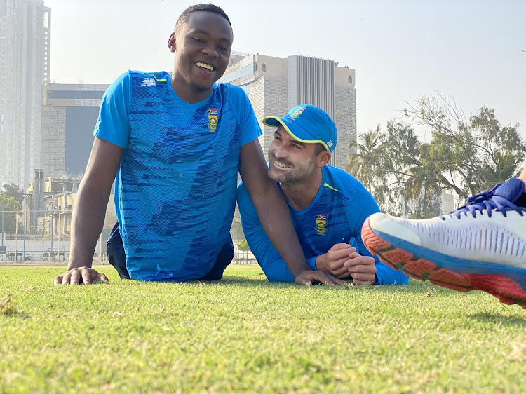Proteas premier fast bowler Kagiso Rabada share a laugh with opener Dean Elgar after a training session in Karachi in Pakistan.