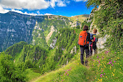Hikers on a narrow trail in the Bucegi mountains, Romania. The Eastern European country is becoming more popular with adventurous South Africans.