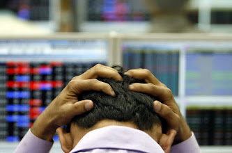 Photo: An Indian broker reacts while trading at a stock brokerage firm in Mumbai, January 22, 2008. Shares from Sydney to London sank for a second day on Tuesday, dragging commodity prices with them and promising similar falls for Wall Street as investors abandoned assets exposed to the risk of a global economic slowdown. REUTERS/Arko Datta (INDIA)