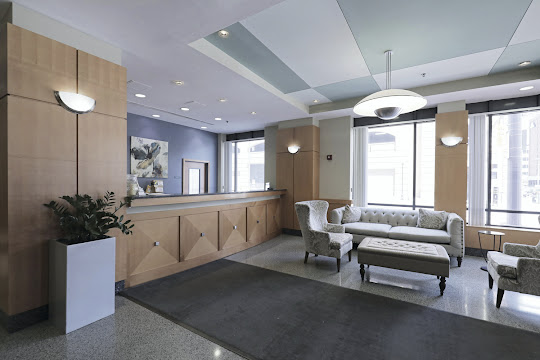 Apartment lobby with furniture and front desk
