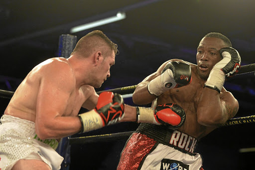 Thabiso Mchunu, right, lost to Constantin Bejenaru in a WBC cruiseweight division in the US over the weekend.