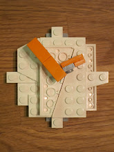 Photo: A clock.  I once heard that Lego designer applicants are given a bucket of square bricks and told to build a circle.  So I tried to make a circle, but it was difficult with these pieces.  Like almost all the designs, this is a solid one-piece structure.