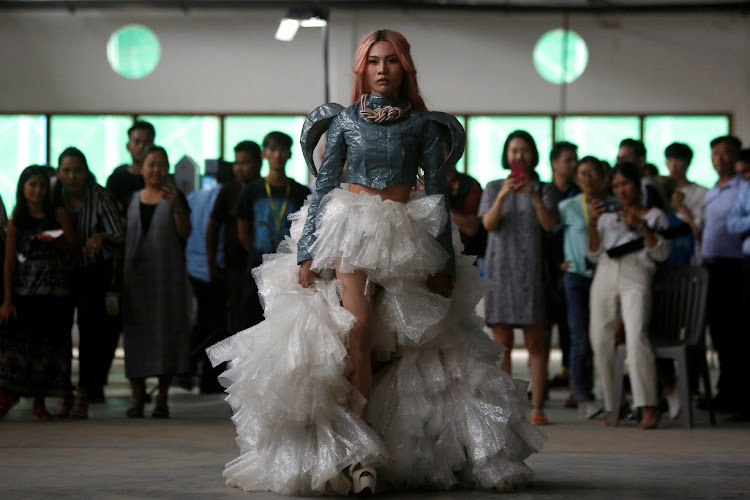 A model wears a dress made out of recycled material during a show organised by LGBT fashion designers to battles discrimination in Phnom Penh, Cambodia.