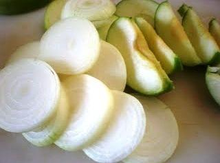 Peel onions and cut them into wedges or thick rings, do not separate the...