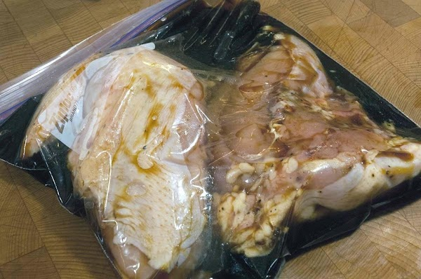 Add the marinade to the bag, squeeze out as much air as possible and...