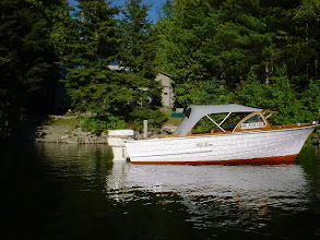 Photo: 16 ft Oldtown runabout. Beautiful wood 16ft runabout with twin Johnson Super Sea Horse outboard motors. Very nice paint and varnish with nice original top and seat cushions. Nice Holsclaw vintage trailer. Last of the Oldtown wooden runabouts. $9500
