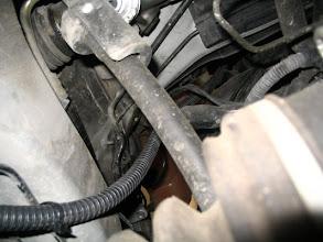 Photo: Bajante por el vano del motor
