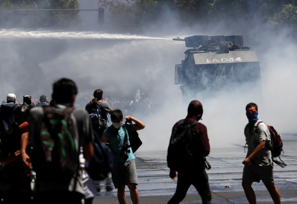 Chile's president fires eight ministers after protests
