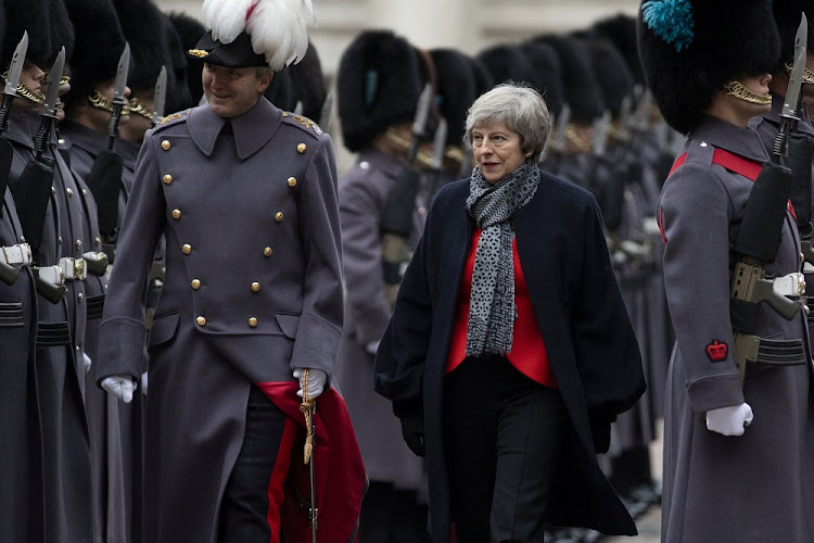Prime Minister Theresa May walks with senior British Army officer Maj-Gen Benjamin John Bathurst in London, Britain, January 10 2019. Picture: DAN KITWOOD/REUTERS