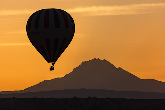 Photo: Göreme Sunrise  This is one of the hundred or so hot air balloons that make their way across the town of Göreme in Turkey first thing every morning. The 3,916m high Mount Erciyes is in the background.  #TurkishThursday +Turkish Thursday by +Baki Karacay #SilhouettesOnThursday by +Siddharth Pandit #TravelThursday  by +Laura Mitchum