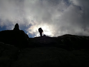 Photo: A hiker topping out on Mount Marcy.