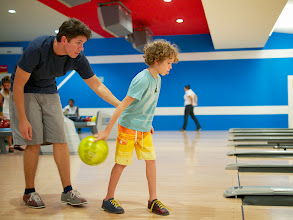 Photo: Ross passing along his bowling expertise to a determined Tobias!