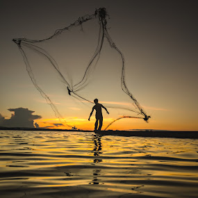 Fishermen fishing at dusk. by Visoot Uthairam - People Street & Candids ( countryside, cool, orange, thailand, boat, net, photo, photography, rural, asian, country, new, color, fresh, sunset, shadow, outdoor, dark, asia, light, black )