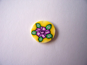 """Photo: Purple Rose and leaves. The space surrounding the flower is Yellow. $4.00 per inch long with a Diameter of 1/2"""" inch around."""