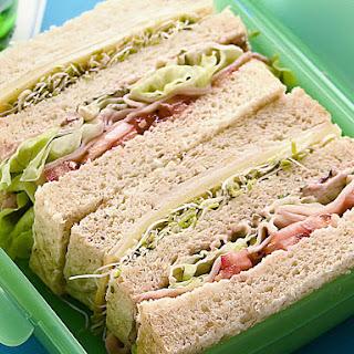 Ham and Turkey Triple Decker Sandwich.