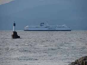 Photo: The BC ferry traveling between Comox and Powell River. Cyril Rock light is in the foreground.