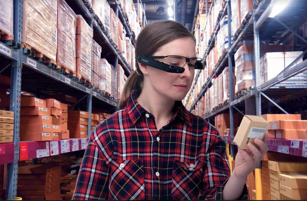 Woman in warehouse with smart glasses