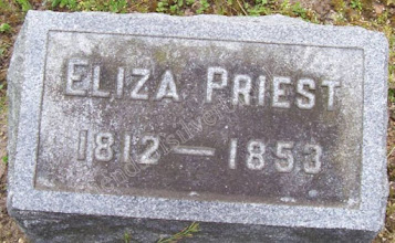 Photo: Priest, Eliza