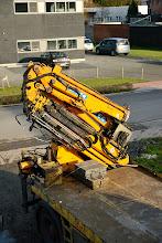 Photo: 20-11-2012 © ervanofoto De kraan is terug ingevouwen, de kraanman kan met zijn wagen terug vertrekken.