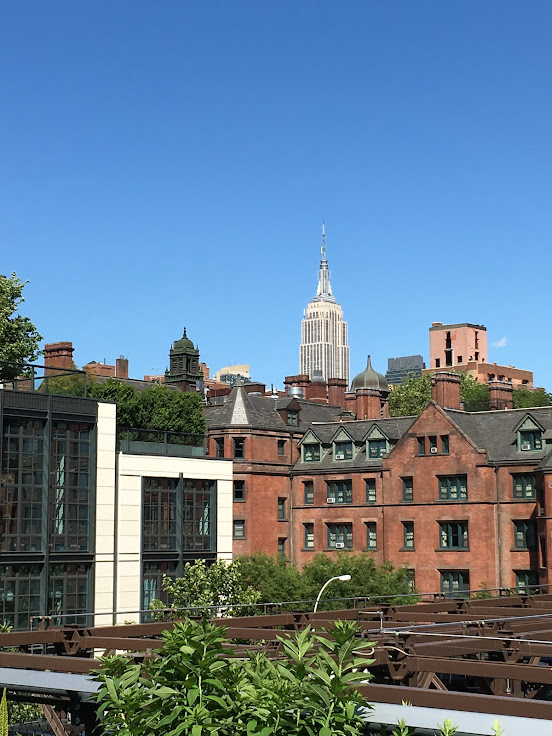 The Empire State Building stands above the western wall of the former General Theological Seminary.