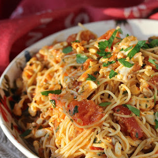 Spicy Angel Hair Pasta with Halibut and Tomatoes.