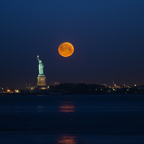 by Logan Knowles - Buildings & Architecture Statues & Monuments ( moonset, statue of liberty, red moon, blue hour, monument, morning )