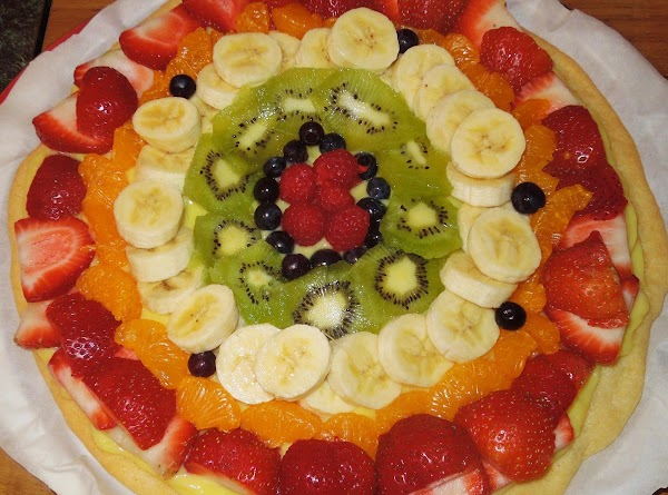 Arrange fruit starting from the outside in.  Slightly layering them on the edges...