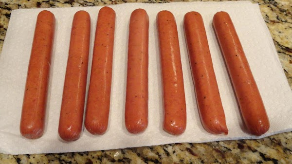Rinse the hot dogs and pat dry with a paper towel. Set aside.