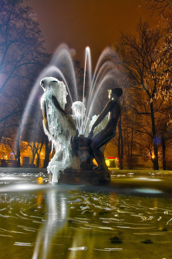 Ice Fountain by Mladen Bozickovic - Buildings & Architecture Statues & Monuments ( exposure, water, tatues, sprinkle, fountain, outdoor, night, light )