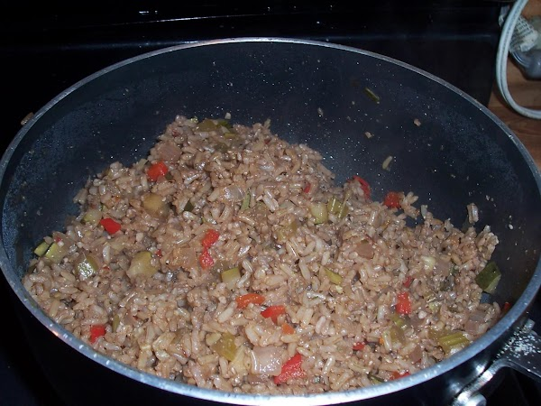 Add rice and bring back to a boil then turn down to a simmer...