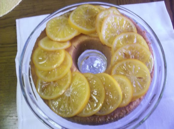 Once cooled, lift slices from syrup and place on top of cooled cake. Again,...