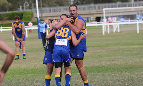 om Denyer, Tom Carberry (number 88) and Daniel Hughes celebrate a Carberry fourth quarter goal which edged the Narrabri Eagles towards its second win of the season. The trio starred in the 11-point win against New England Nomads. Hughes kicked four goals, Carberry three and Denyer eight behinds, and the three were among the best on ground recipients.