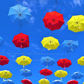 Colourful umbrellas by street by Svetlana Saenkova - Digital Art Things ( street art, blue sky, colourful, umbrellas,  )