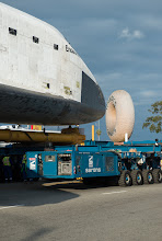 Photo: The nose cone of the space shuttle Endeavour is seen next to the Randy's Donuts landmark in Inglewood, California, Friday, Oct. 12, 2012. Endeavour, built as a replacement for space shuttle Challenger, completed 25 missions, spent 299 days in orbit, and orbited Earth 4,671 times while traveling 122,883,151 miles. Beginning Oct. 30, the shuttle will be on display in the CSC's Samuel Oschin Space Shuttle Endeavour Display Pavilion, embarking on its new mission to commemorate past achievements in space and educate and inspire future generations of explorers. Photo Credit: (NASA/Carla Cioffi)