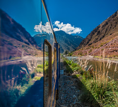 Photo: And the Train Said to the Mountain... Ollantaytambo, Peru  En Route to Machu Picchu Pueblo (Aguas Calientes), we were bless with the most stunning train ride. Picture 6 photographers hanging from train windows (while moving) with all manner of big lenses, and that was us. I can't image what the rest of the passengers thought, and Colby sat watching us with amusement :) Well there are advantages of hanging from train windows, and one of them is the reflection potential.  #speedysaturday  curated by +Kathryn Brown #tglperu