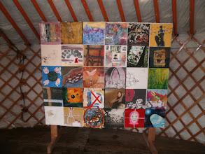 """Photo: After exhibitions in Denmark, Holland, Portugal and Canada, The Human Rights flag created by 29 artists from 20 different countries, all members of the GLOBAL VILLAGE CREARTIST group in Facebook will be exhibited in the exhibition """"Border breaking Art"""": """"Grænseoverskridende Kunst"""" i Skulpturhaven i Thy, hvor landsbyen Svankjær omdannes til en Skulpturlandsby Fernisering (VERNISSAGE) lørdag d. 25.maj kl. 13.30 med flere musikalske indslag og events."""