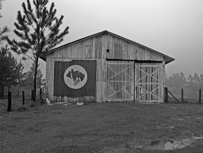 Photo: The MST banner painted on a shed at the entrance of the Assentamento, Prefessor Luiz D. Macedo. I had the extreme privilege of visiting the assentameno during my trip to Brazil in the summer of 2008.