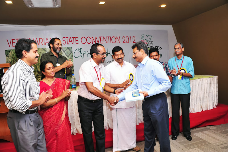 Photo: Dr. K. R. Arunkumar, President, IVA, Kerala, handing over the the book Atlas of Transboundary Animal Diseases', published by Oie, to Dr. George T Oommen, Professor and Head, Departmet of Livestock Products Technology during IVA State convention at Wynad.This book was donated by Dr.P. K. Shihabudheen (1984 batch) to Veterinary College library, who received this from Oie for publishing photos of Highly Pathogenic Avian Influenza in Falcons.