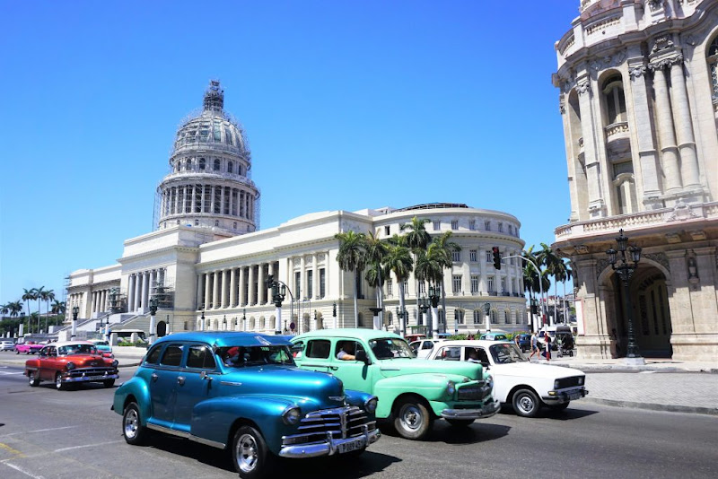 Vintage cars in front of government buildings in Havana.